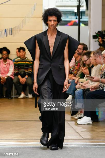 Model walks the runway during the JW Anderson Menswear Spring Summer 2020 show as part of Paris Fashion Week on June 19, 2019 in Paris, France.