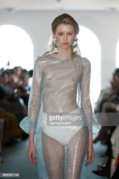 Model walks the runway during the Karla Spetic show at Mercedes-Benz Fashion Week Resort 19 Collections at The Blue Room Bondi on May 14, 2018 in...