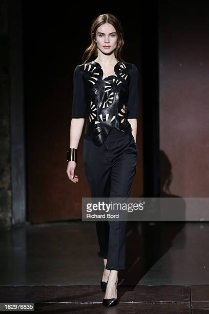 A model walks the runway during the Kaviar Gauche Fall/Winter 2013 ReadytoWear show as part of Paris Fashion Week at Couvent Des Recollets on March 2...