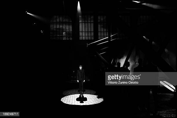 A model walks the runway during the Kenzo fashion show as part of Pitti Immagine Uomo 83 at Mercato Centrale on January 10 2013 in Florence Italy