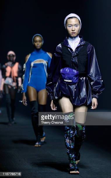 Model walks the runway during the Kenzo Menswear Spring Summer 2020 show as part of Paris Fashion Week on June 23, 2019 in Paris, France.