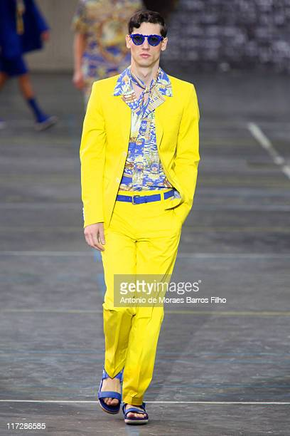 A model walks the runway during the Kenzo Menswear Spring/Summer 2012 show as part of Paris Fashion Week at Lycee Carnot on June 25 2011 in Paris...