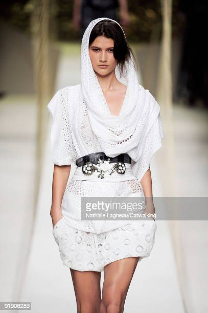 A model walks the runway during the Kenzo Pret a Porter show as part of the Paris Womenswear Fashion Week Spring/Summer 2010 at Palais De Tokyo on...