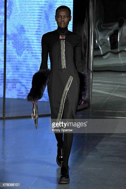 A model walks the runway during the Kenzo show as part of Paris Fashion Week Womenswear Fall/Winter 20142015 on March 2 2014 in Paris France