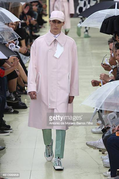 A model walks the runway during the Kenzo show as part of the Paris Fashion Week Menswear Spring/Summer 2015 on June 28 2014 in Paris France