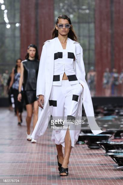 A model walks the runway during the Kenzo show at 'Cite du Cinema' of SaintDenis as part of the Paris Fashion Week Womenswear Spring/Summer 2014 on...