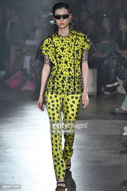 A model walks the runway during the Kenzo Spring/Summer 2019 fashion show as part of Paris Fashion Week on June 24 2018 in Paris France
