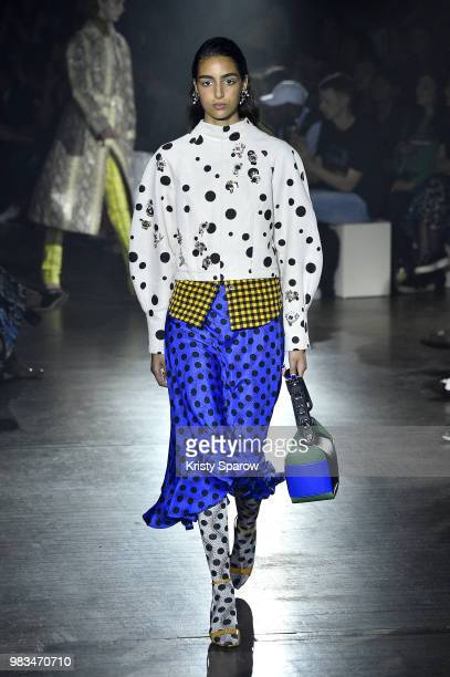 A model walks the runway during the Kenzo Spring/Summer 2019 show as part of Paris Fashion Week on June 24 2018 in Paris France