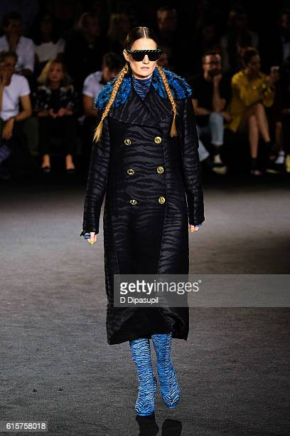 A model walks the runway during the KENZO x HM Collection launch event at Pier 36 on October 19 2016 in New York City