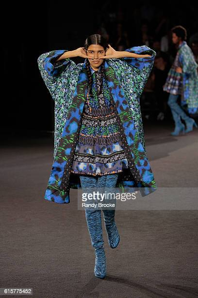 A model walks the runway during the Kenzo X HM fashion show at Pier 36 on October 19 2016 in New York City