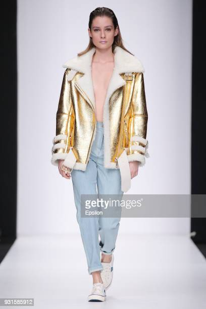 A model walks the runway during the KETIONE fashion show at Mercedes Benz Fashion Week Russia Fall/Winter 2018/19 at Manege on March 13 2018 in...
