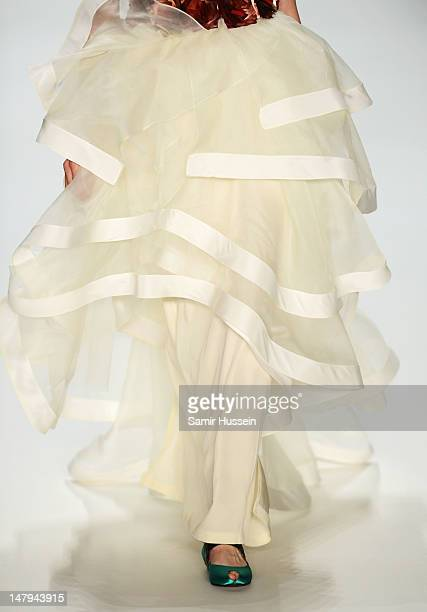 A model walks the runway during the Kilian Kerner Show at MercedesBenz Fashion Week Spring/Summer 2013 on July 6 2012 in Berlin Germany