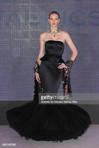 A model walks the runway during the King of Fabrics show as a part of the Malaysia Eleganza 2014 hosted by Datin Paduka Seri Rosmah Mansor At Pre...
