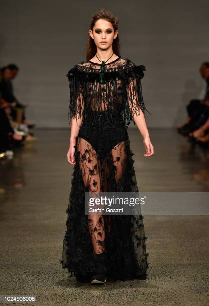 A model walks the runway during the Kiri Nathan show during New Zealand Fashion Week 2018 at Viaduct Events Central on August 29 2018 in Auckland New...
