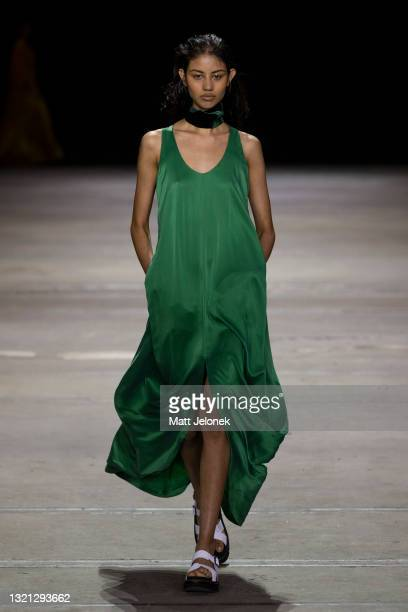 Model walks the runway during the KITX show during Afterpay Australian Fashion Week 2021 Resort '22 Collections at Carriageworks on June 2, 2021 in...
