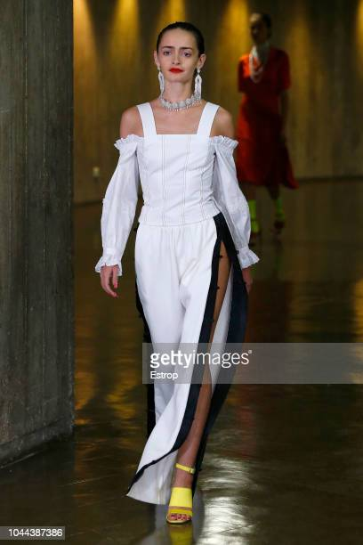 A model walks the runway during the Koche show as part of the Paris Fashion Week Womenswear Spring/Summer 2019 on September 25 2018 in Paris France
