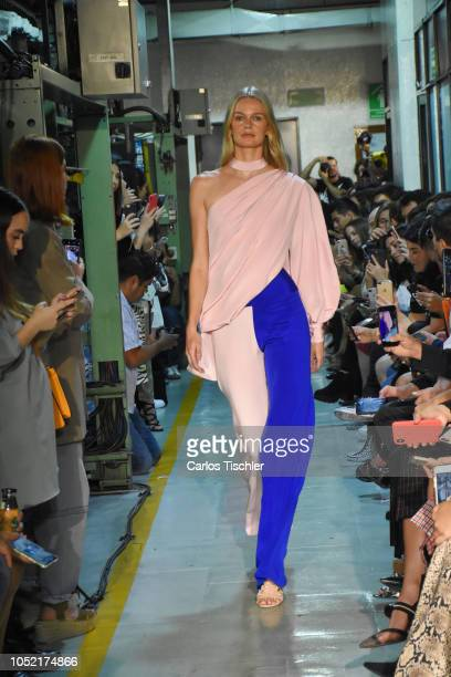 A model walks the runway during the Kris Goyri fashion show as part of the MercedesBenz Fashion Week Mexico Spring/Summer 2019 at Universal newspaper...