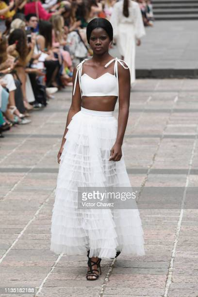 A model walks the runway during the Kris Goyri fashion show as part of the MercedesBenz Fashion Week Mexico Fall/Winter 2019 Day 5 at Bosque de...
