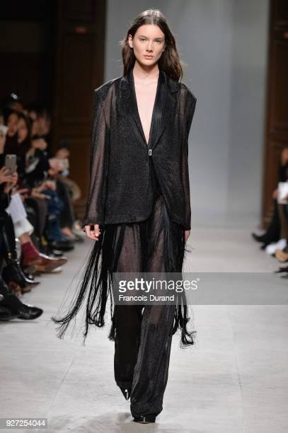A model walks the runway during the Kristina Fidelskaya show as part of the Paris Fashion Week Womenswear Fall/Winter 2018/2019 on March 4 2018 in...