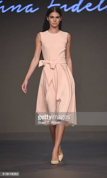 A model walks the runway during the Kristina Fidelskaya show at Fashion Forward Fall/Winter 2016 held at the Dubai Design District on March 31 2016...