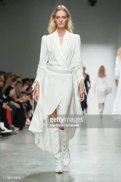 Model walks the runway during the Kristina Fidelskaya Womenswear Spring/Summer 2020 show as part of Paris Fashion Week on September 30, 2019 in...