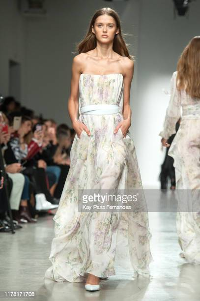 Model walks the runway during the Kristina Fidelskaya Womenswear Spring/Summer 2020 show as part of Paris Fashion Week on September 30, 2019 in...
