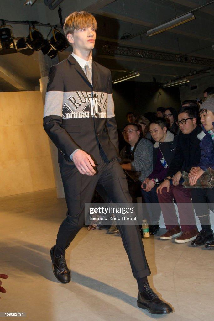 A model walks the runway during the Krisvanassche Men Autumn / Winter 2013 show as part of Paris Fashion Week on January 18, 2013 in Paris, France.