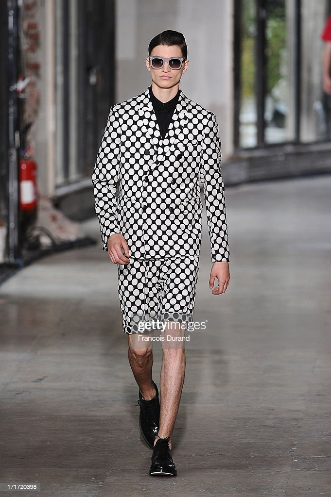 A model walks the runway during the Krisvanassche Menswear Spring/Summer 2014 show as part of the Paris Fashion Week on June 28, 2013 in Paris, France.