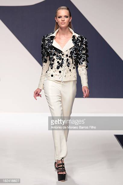 A model walks the runway during the Krizia show as a part of Milan Fashion Week Womenswear S/S 2013 on September 20 2012 in Milan Italy