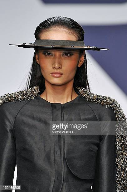Model walks the runway during the Krizia show as a part of Milan Fashion Week Womenswear S/S 2013 on September 20, 2012 in Milan, Italy.