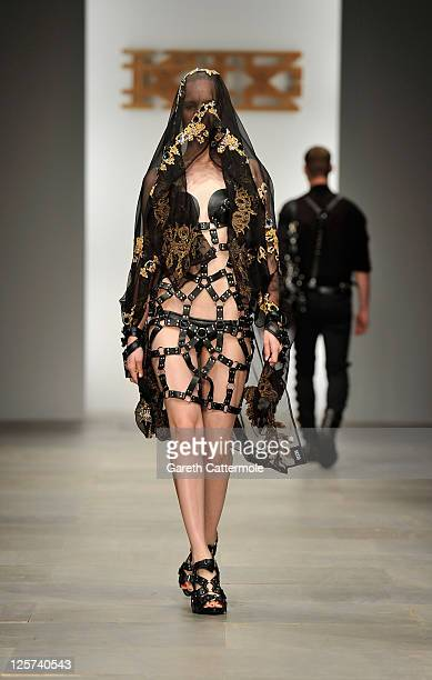 A model walks the runway during the KTZ show at London Fashion Week Spring/Summer 2012 on September 21 2011 in London United Kingdom