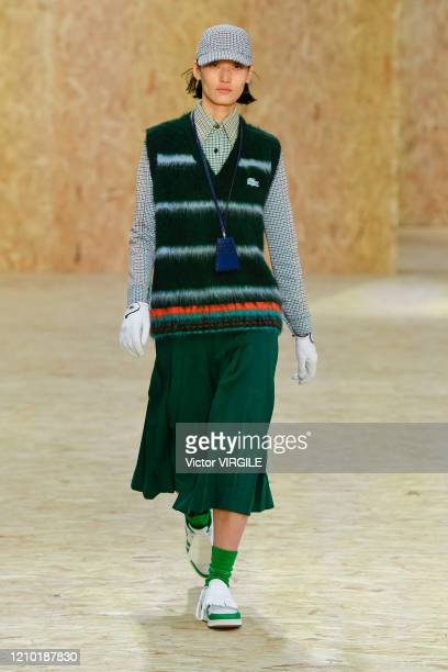 Model walks the runway during the Lacoste Ready to Wear fashion show as part of the Paris Fashion Week Womenswear Fall/Winter 2020-2021 on March 03,...