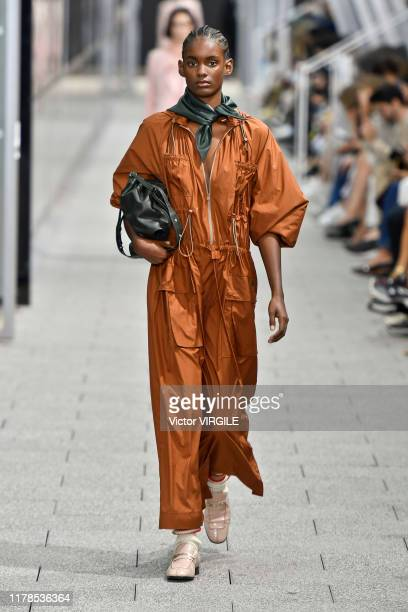 A model walks the runway during the Lacoste Ready to Wear Spring/Summer 2020 fashion show as part of Paris Fashion Week on October 1 2019 in Paris...