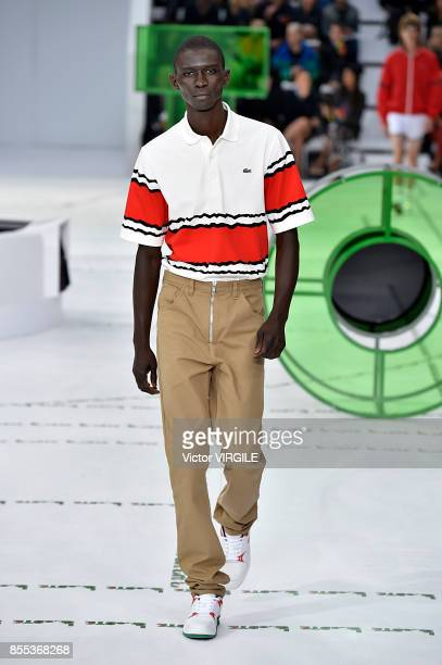 Model walks the runway during the Lacoste Ready to Wear Spring/Summer 2018 fashion show as part of the Paris Fashion Week Womenswear Spring/Summer...