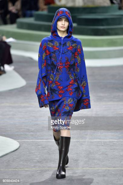 A model walks the runway during the Lacoste show as part of Paris Fashion Week Womenswear Fall/Winter 2018/2019 on February 28 2018 in Paris France