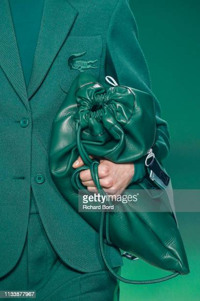 Model walks the runway during the Lacoste show as part of the Paris Fashion Week Womenswear Fall/Winter 2019/2020 at Tennis Club de Paris on March...