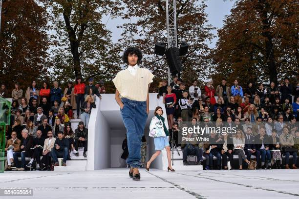 A model walks the runway during the Lacoste show as part of the Paris Fashion Week Womenswear Spring/Summer 2018 on September 27 2017 in Paris France