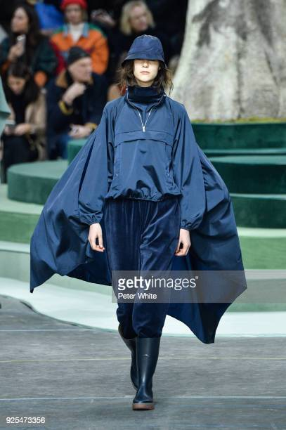 A model walks the runway during the Lacoste show as part of the Paris Fashion Week Womenswear Fall/Winter 2018/2019 on February 28 2018 in Paris...