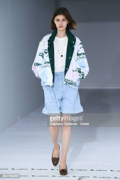 A model walks the runway during the Lacoste Spring Summer 2018 show as part of Paris Fashion Week at on September 27 2017 in Paris France