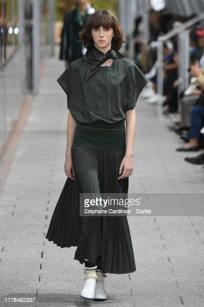 A model walks the runway during the Lacoste Womenswear Spring/Summer 2020 show as part of Paris Fashion Week on October 01 2019 in Paris France