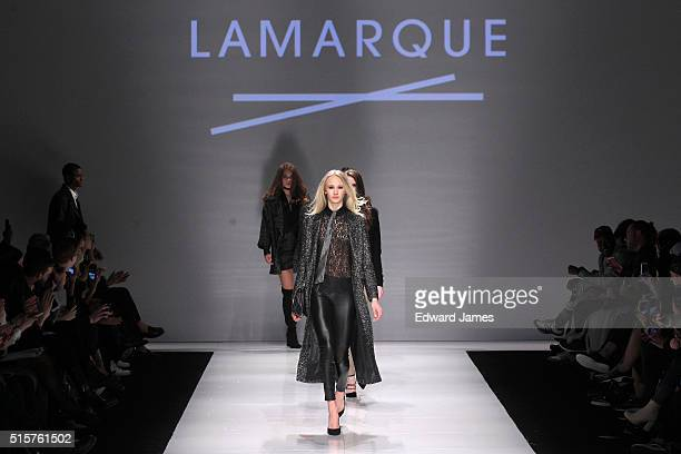 A model walks the runway during the Lamarque fashion show at David Pecaut Square on March 15 2016 in Toronto Canada