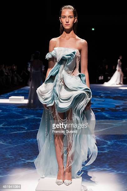 A model walks the runway during the Lan YU show as part of Paris Fashion Week Haute Couture Fall/Winter 20142015 at Grand Palais on July 9 2014 in...