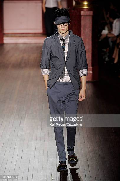 A model walks the runway during the Lanvin fashion show at Paris Fashion Week Menswear Spring/Summer 2010 on June 28 2009 in Paris France