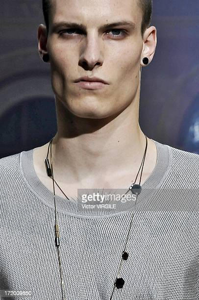 A model walks the runway during the Lanvin Menswear Ready to Wear Spring/Summer 2014 show as part of the Paris Fashion Week on June 30 2013 in Paris...
