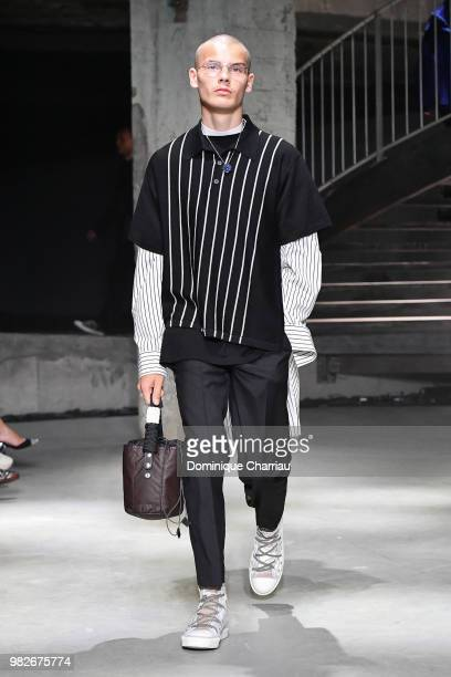 A model walks the runway during the Lanvin Menswear Spring/Summer 2019 show as part of Paris Fashion Week on June 24 2018 in Paris France