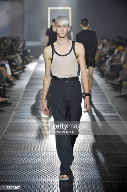Model walks the runway during the Lanvin Ready to Wear Spring/Summer 2013 show as part of the Paris Men Fashion Week on July 01, 2012 in Paris,...