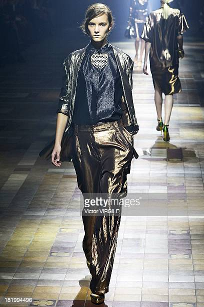 A model walks the runway during the Lanvin show as part of Paris Fashion Week Womenswear Spring/Summer 2014 on September 26 2013 in Paris France