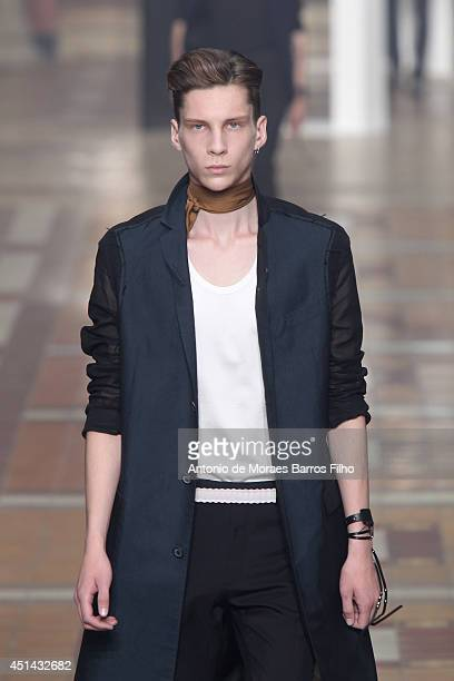 Model walks the runway during the Lanvin show as part of the Paris Fashion Week Menswear Spring/Summer 2015 on June 29, 2014 in Paris, France.