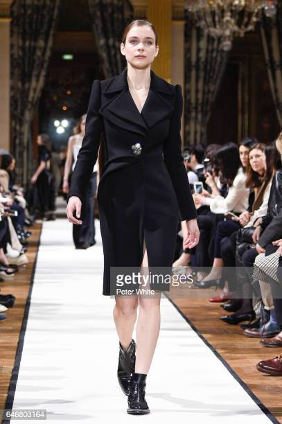 A model walks the runway during the Lanvin show as part of the Paris Fashion Week Womenswear Fall/Winter 2017/2018 on March 1 2017 in Paris France