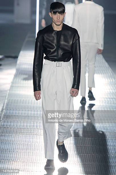 Model walks the runway during the Lanvin Spring / Summer 2013 show as part of Paris Fashion Week on July 1, 2012 in Paris, France.